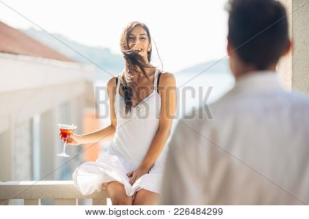 Attractive Woman Drinking Cocktail And Enjoying Her Summer Vacation.drinking Refreshing Drink And Sm