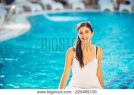 Attractive Young Woman Relaxing At  Luxury Vacation Resort Pool.enjoying Summer.vacation Mood.girl A