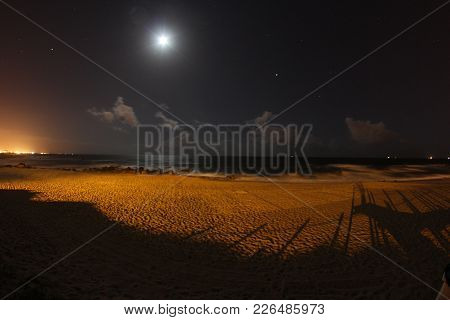 Moon And Stars At Night On Madalena Beach