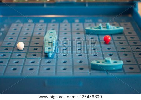 Image Board Game Sea Battle With A Playing Field And Plastic Figures Of Ships And Marks On The Battl