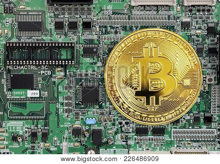 Golden Coin Of Bitcoin Crypto Currency, New Digital Money In Cyber World, On The Background Of Elect