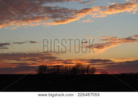 Beautiful Sunset With Trees In Background Located In Kansas