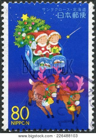 Japan - Circa 1999: A Stamp Printed In Japan, The Prefecture Hokkaido, Depicts Children In A Sleigh