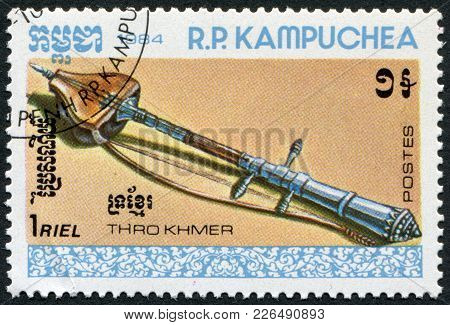 Kampuchea-circa 1984: A Stamp Printed In The Cambodia, Shows A Traditional Musical Instrument Thro K