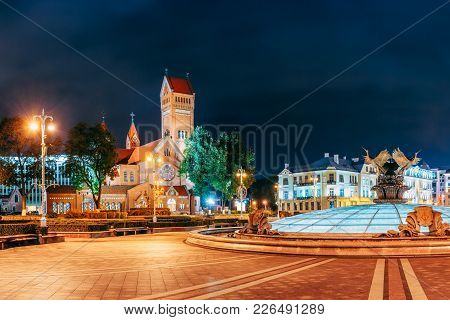 Minsk, Belarus. Night View Church Of Saints Simon And Helen Or Red Church In Independence Square. Th