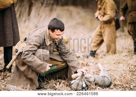 Pribor, Belarus - April, 04, 2015: Unidentified Re-enactor Dressed As Soviet Soldier In Overcoat Dur