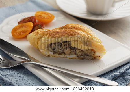 Omelet roll with roasted mushrooms
