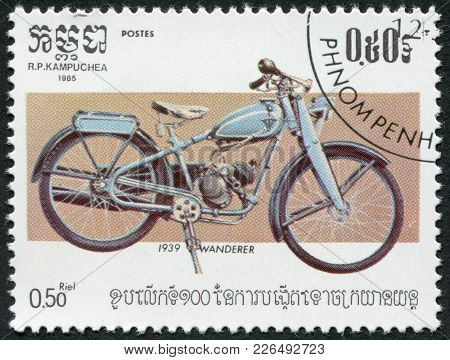Kampuchea-circa 1985: A Stamp Printed In The Cambodia, Depicts A Motorcycle Wanderer, Circa 1985