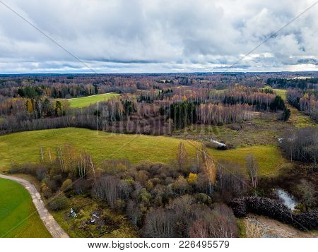 Drone Photography Of A Countryside Of Latvia - Forests In Cloudy Autumn Day