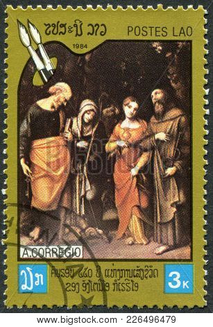 Laos-circa 1984: A Stamp Printed In The Laos, Depicts A Picture The Four Saints, Painter Antonio Da