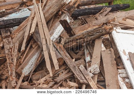 A Pile Of Small Pieces Of Wooden Scrap On The Street