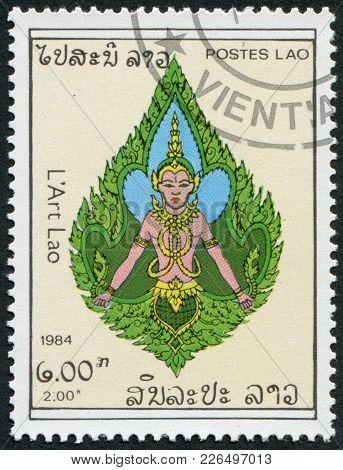 Laos-circa 1984: A Stamp Printed In The Laos, Depicts A Deity, Circa 1984