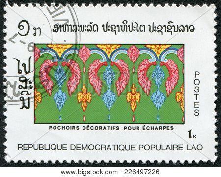 Laos-circa 1988: A Stamp Printed In The Laos, Depicts Decorative Stencils, Scarf, Circa 1988