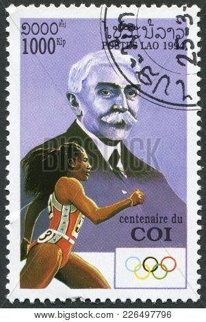 Laos-circa 1994: A Stamp Printed In The Laos, Depicts Baron De Coubertin, Olympic Runner, Circa 1994
