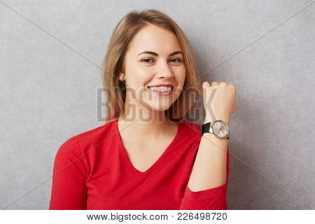 Happy Beautiful Woman With Pleasant Broad Smile Shows Her New Wristwatch, Being Delightful To Reciev