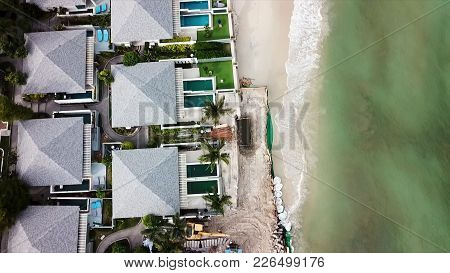 Aerial View On Coastline, Sea And Waves. Video. Top View Of A Drone At The Beach. Top View Of An Ama