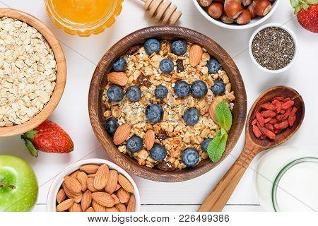 Homemade Granola With Nuts And Raisins, Blueberries, Dried Goji Berries, Chia Seeds And Yogurt. Top