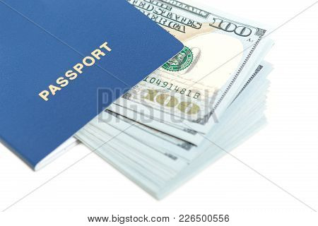Dollars In Passport Isolated Over White Background. Foreign Passport With Banknote. Free Travel To E