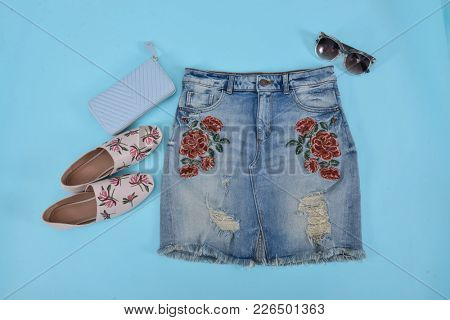 embroidery,floral,rose female Jeans skirt, shoes, bag,sunglasses on blue background