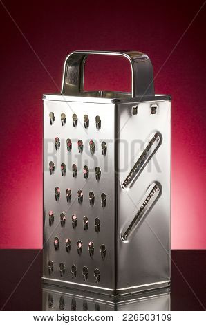 Metal Stainless Steel Grater Isolated On Gradient Background