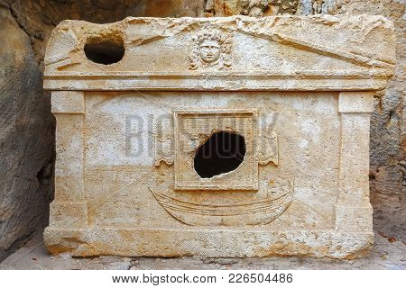 The Ancient Burial Place Of The Greek Civilization. On The Tomb There Is An Image Of A Man And A Boa