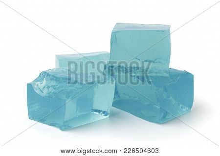 The Blue Ice Cubes On A White Background, Isolated.
