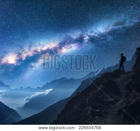 Space With Milky Way, Girl And Mountains. Silhouette Of Standing Woman On The Mountain Peak, Mountai
