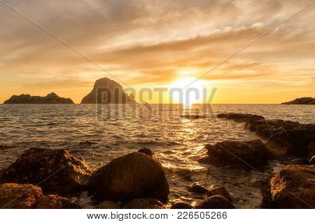 Sunset In Ibiza Next To The Island Of Es Vedra