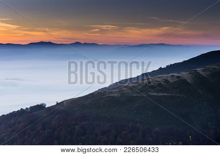 Multisite Horizon. Sunrise In The Mountains. The Frame Is Divided Into Triangles. Mountains In The F