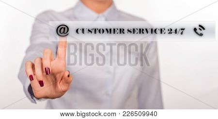 Business, Technology And Internet Concept - Businesswoman Pressing 24/7 Support Button On Virtual Sc