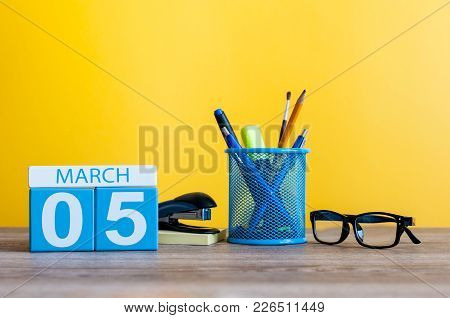 March 5th. Day 5 Of March Month, Calendar On Table With Yellow Background And Office Or School Suppl