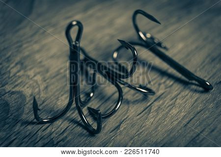 Sharp Fish Hooks Photographed Close-up. Sharpened Hook Will Not Give A Chance To Fish To Escape From