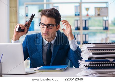 Stressed businessman thinking of suicide due to excessive worklo