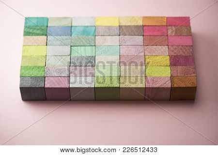 Spring colors. Spectrum of multi colored wooden blocks aligned. Background or cover for something creative or diverse.