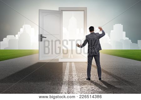 Businessman in front of door in business opportunities concept