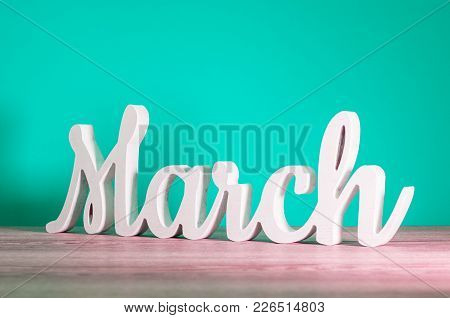March - Wooden Carved Letters. Beginning Of March Month, Calendar On Light Turquoise Background. Spr
