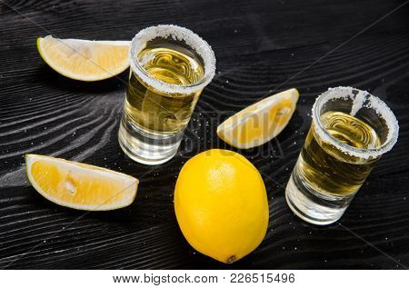 Tequila drink served in glasses with lime and salt