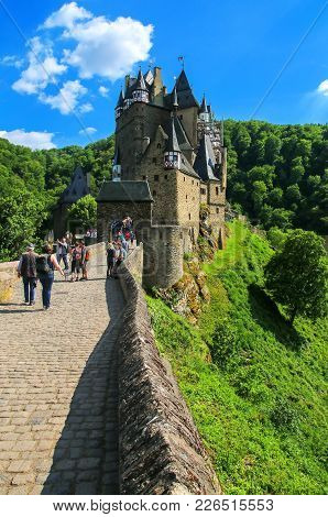 Eltz, Germany - May 25: Unidentified People Walk To The Eltz Castle On May 25, 2017 In Rhineland-pal
