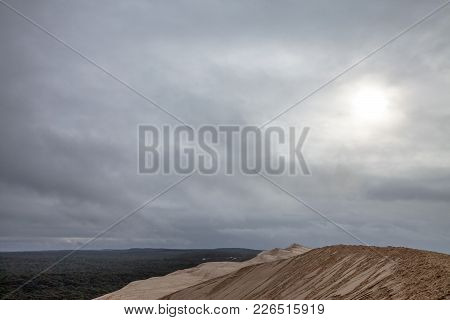 Panorama Of The Pilat Dune (dune Du Pilat) During A Cloudy Afternoon With A Pine Forest In Backgroun