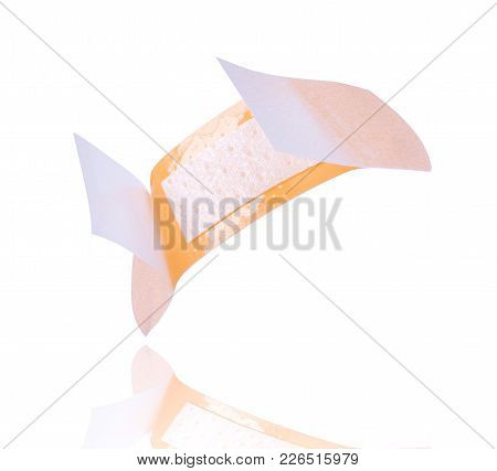 Open Medical Adhesive Plaster Close-up, Isolated On White Background