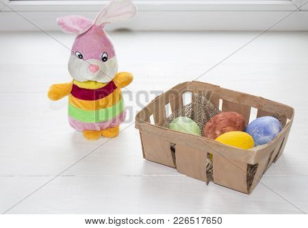 Easter Concept. Small Bunny Rabbit Arranged In Easter Background.