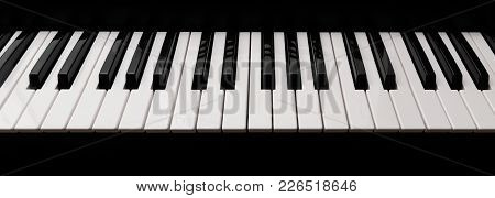 Grand Piano Keyboard With Glossy Black And White Keys As A Music Background In Wide Panoramic Banner