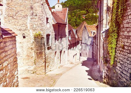 Old Tranquil Street Of Besancon With Brick Houses In Summer