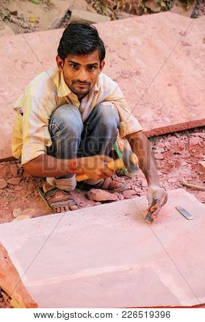 Agra, India - November 8: Unidentified Man Works With A Piece Of Sandstone Outside Taj Mahal Complex