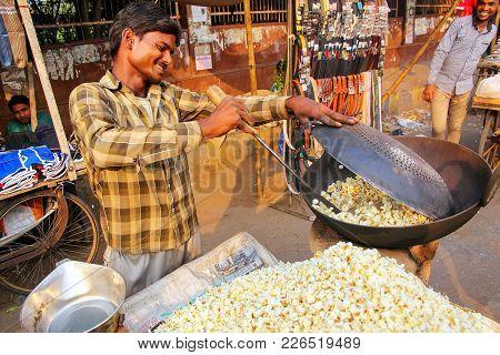 Agra, India - November 10: Unidentified Man Sells Popcorn At Kinari Bazaar On November 10, 2014 In A