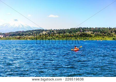 Canoeing On Lake Villarica Chile Overlooking The Volcano Villarrica Kayak On Lake Villarica.