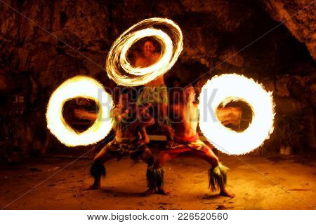 Tongatapu, Tonga - November 13: Unidentified Men Perform Fire Dance (blurred Motion) In Hina Cave On