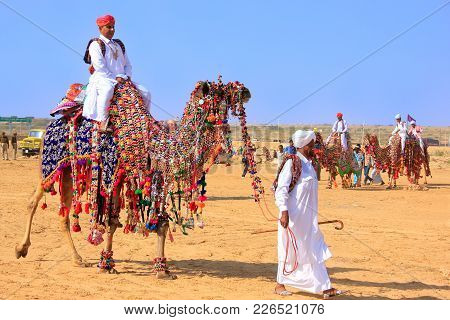 Jaisalmer, India - February 17: Unidentified Man Rides Camel During Desert Festival On February 17,