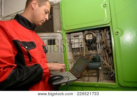 Yoshkar-ola, Russia - October 8, 2015 Programming An Electric Meter By An Engineer In A Multi-storey