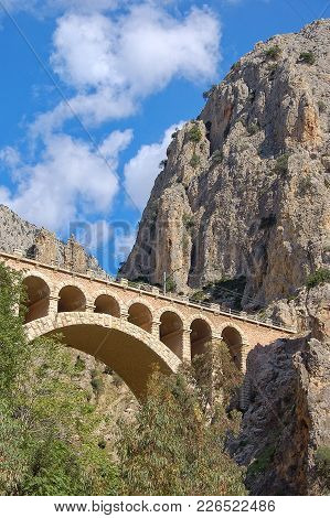 Bridge Between Cliffs In A Limestone Gorge At El Chorro - Malaga, Andalusia, Spain